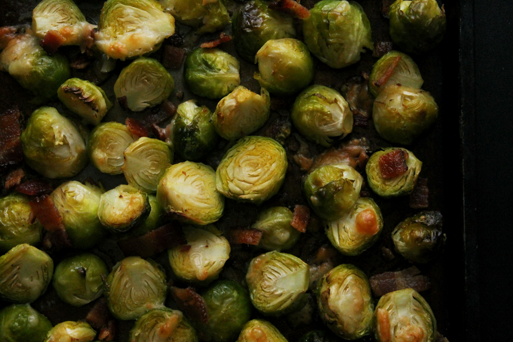 These crispy, savory Roasted Bacon Parmesan Brussels Sprouts are a flavor explosion! Made with 4 basic ingredients, this dish makes for a perfect, healthy side that's sure to please any crowd.