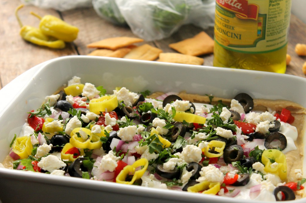 This crowd pleasing 7-Layer Greek Dip will be devoured in minutes and is super easy to make!